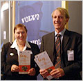 Rosalie Zobel (director of Directorate G: Components and Systems) and Jan Arfwidsson hold the AIDE leaflets in their hands